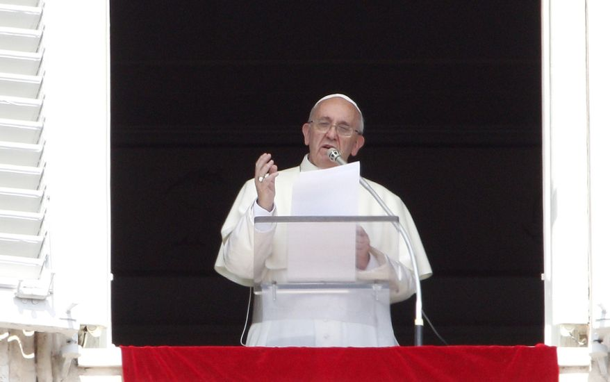 **FILE** Pope Francis recites the Angelus prayer from his studio window overlooking St. Peter's Square at the Vatican on Sept. 1, 2013. (Associated Press)