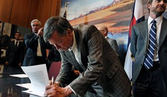Colorado Gov. John Hickenlooper has signed into law every measure sent to him by the Democrat-controlled legislature, including the Voter Access and Modernized Elections Act, passed with no Republican votes. The act allows same-day voter registration and makes mail-in voting the norm. Critics of the law fear it will turn the two recall elections Tuesday into a statewide free-for-all. (Associated Press)