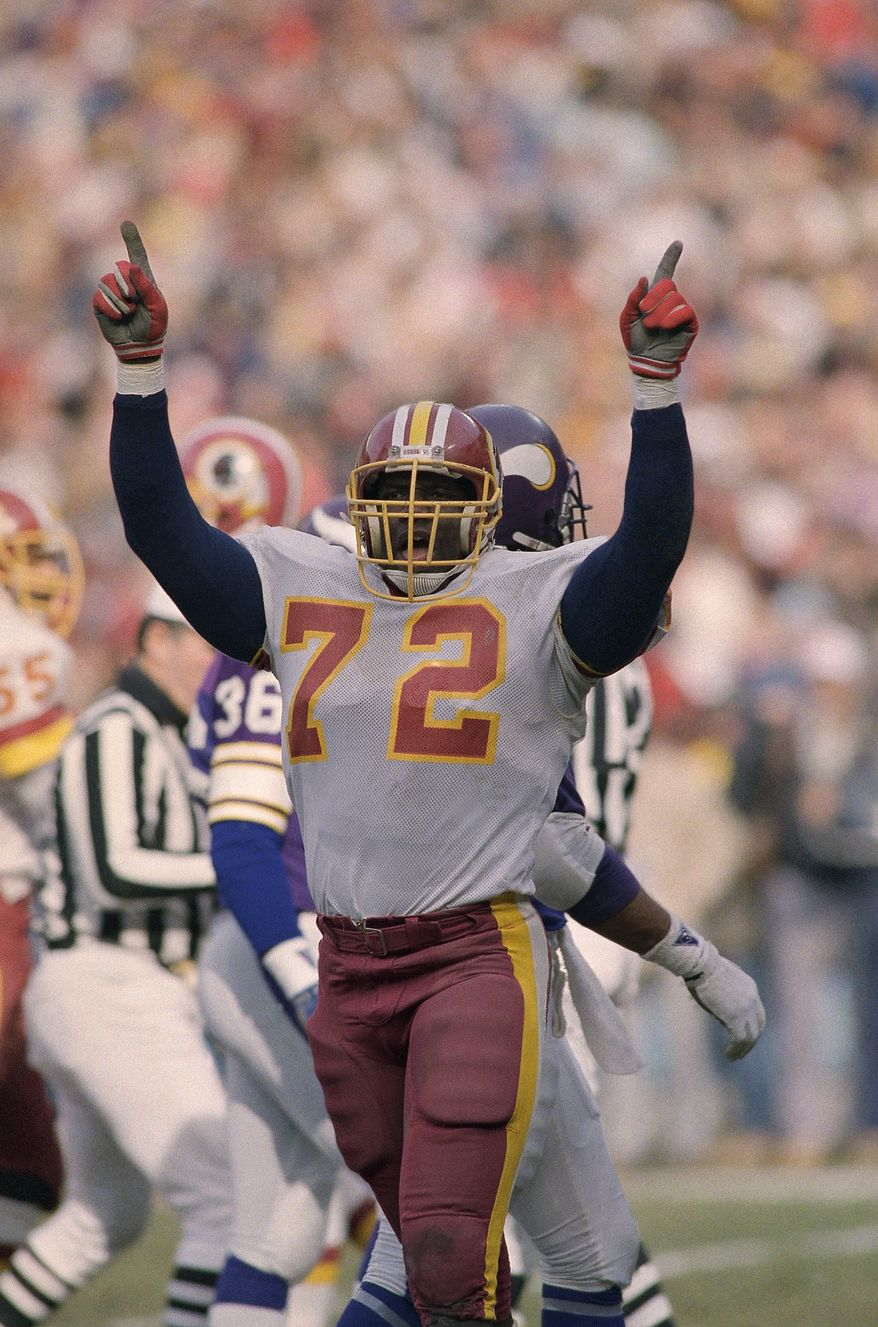 """**FILE** Washington Redskins right end, Dexter Manley (72), raises his arms giving the """"No. 1"""" sign during Sunday's game against the Minnesota Vikings, clinching the NFC Championship for the Redskins in Washington, Jan. 19, 1988. (AP Photo/Rusty Kennedy)"""