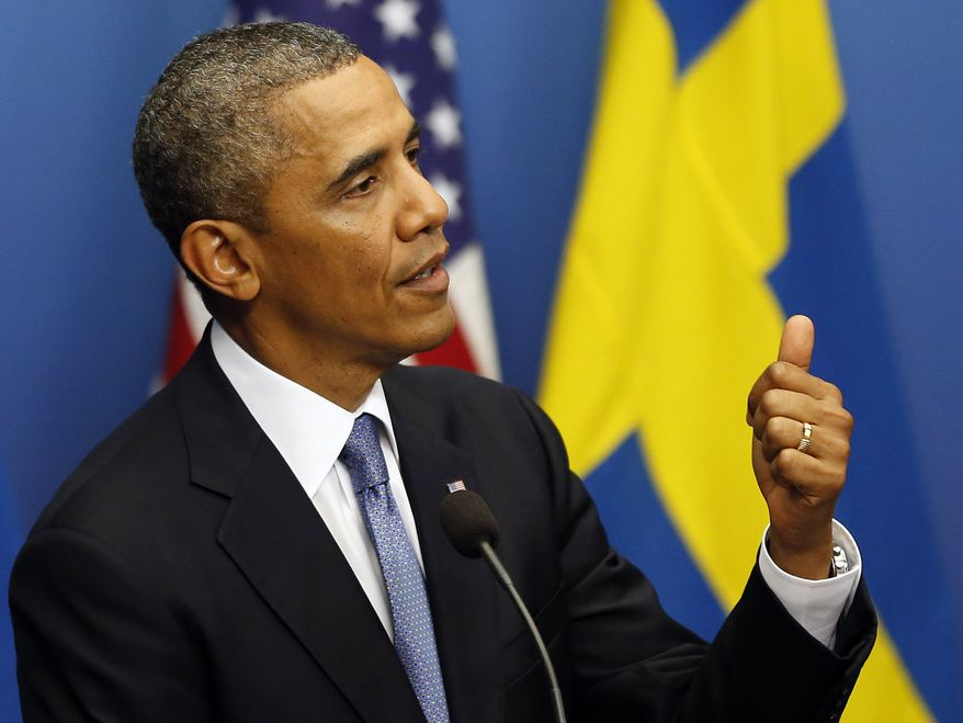 President Obama gestures during a press conference at Rosenbad, the Swedish government building, in Stockholm on Wednesday, Sept. 4, 2013. Mr. Obama is visiting Sweden at the invitation of Prime Minister Fredrik Reinfeldt ahead of the G-20 summit in St. Petersburg. (AP Photo/Frank Augstein)