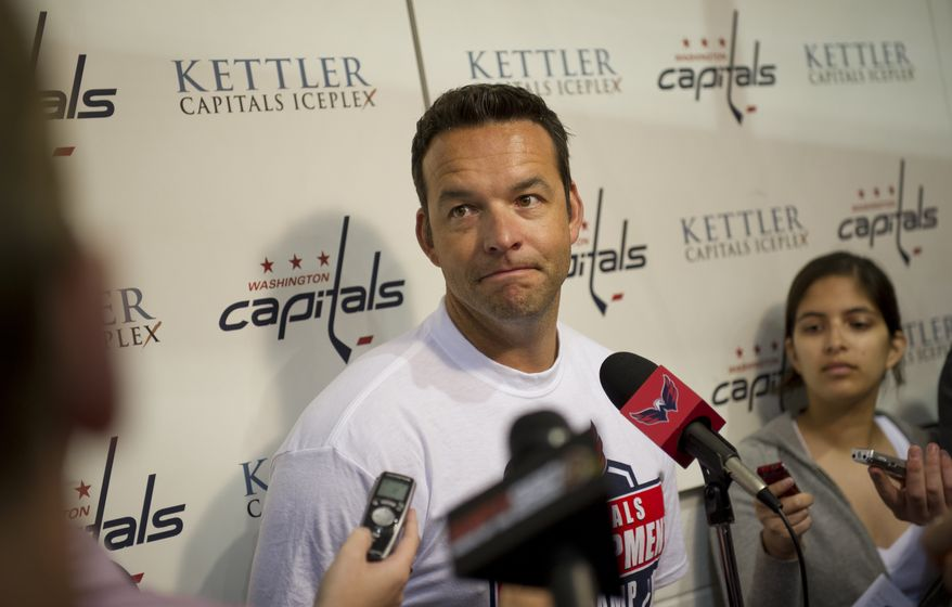 Washington Capitals Associate Goaltender Coach Olie Kolzig talks with reporters during a press conference at the Kettler Capitals Iceplex in Arlington, Va., Monday, July 11, 2011. (Rod Lamkey Jr/The Washington Times)