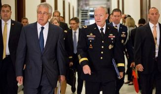 Defense Secretary Chuck Hagel, left, and Joint Chiefs Chairman Gen. Martin Dempsey, right, arrive for a closed-door intelligence briefing for members of the Senate Armed Services Committee, Wednesday, Sept. 4, 2013, on Capitol Hill in Washington, as Barack Obama seeks congressional authorization for military intervention in Syria. (AP Photo/J. Scott Applewhite)
