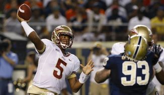 Florida State quarterback Jameis Winston (5) gets off a pass as Pittsburgh defensive lineman Bryan Murphy (93) rushes in the first quarter of the NCAA college football game, Monday, Sept. 2, 2013, in Pittsburgh. (AP Photo/Keith Srakocic)