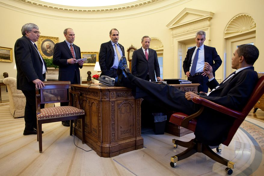 """Feb. 4, 2009 """"The President talks with aides during an impromptu meeting around the Resolute desk."""" (Official White House photo by Pete Souza)"""