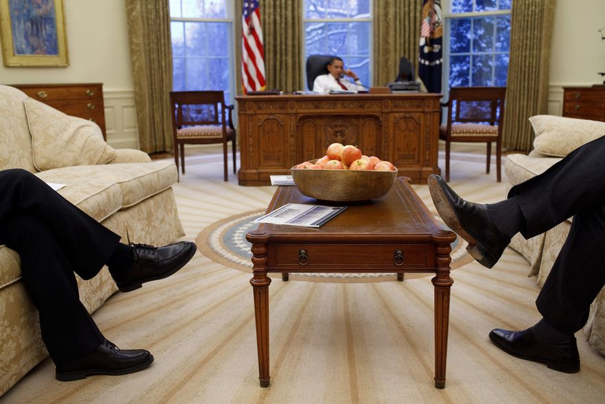 NSC staff members sit in the Oval Office while President Obama talks on the phone with a foreign leader, Jan. 27, 2009. (Official White House Photo by Pete Souza)