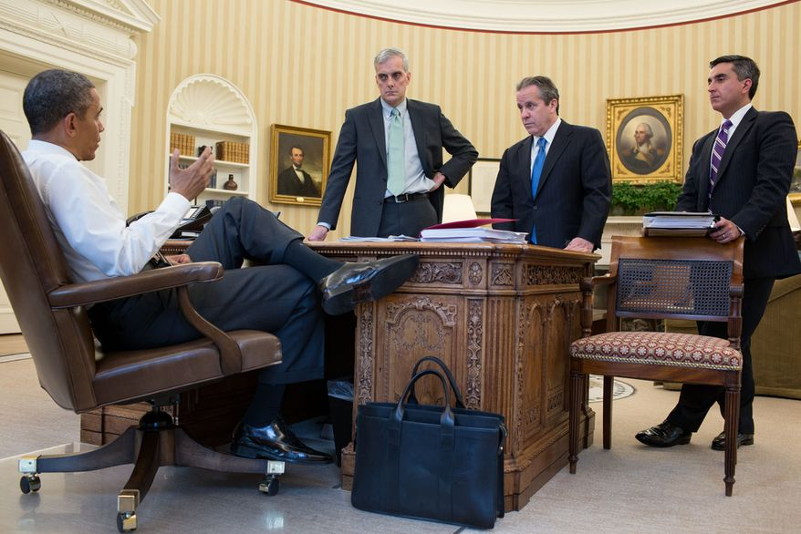 President Barack Obama talks with senior advisors in the Oval Office, May 8, 2013. Standing, from left, are: Chief of Staff Denis McDonough; National Economic Council Director Gene Sperling; and Miguel Rodriguez, Director of Legislative Affairs. (Official White House Photo by Pete Souza)