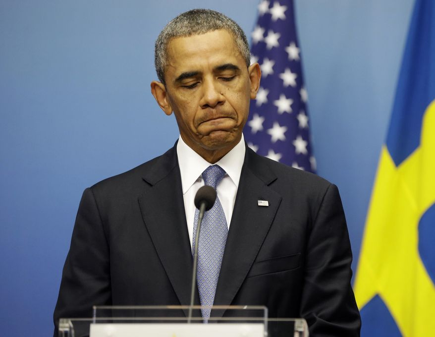 President Barack Obama pauses during his joint news conference with Swedish Prime Minister Fredrik Reinfeldt, Wednesday, Sept. 4, 2013, at the Rosenbad Building in Stockholm, Sweden. The president said international community and Congress credibility on the line on response to Syria. (AP Photo/Pablo Martinez Monsivais)