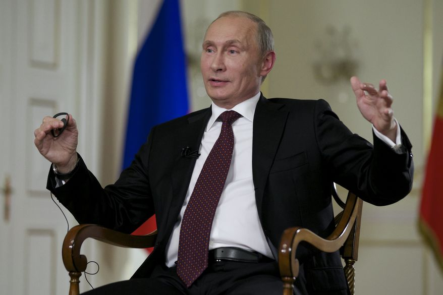 Russian President Vladimir Putin gestures while speaking to John Daniszewski, the Associated Press's Senior Managing Editor for International News, during an AP interview at Putin's Novo-Ogaryovo residence outside Moscow, Russia, Tuesday, Sept. 3, 2013. Putin sought to downplay the current chill in the U.S.-Russian relations and said that the two countries need to cooperate on a range of issues in the interests of global stability, (AP Photo/Alexander Zemlianichenko)