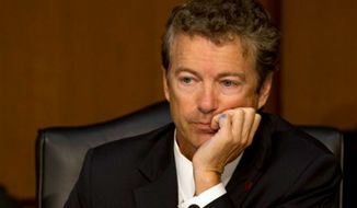 Sen. Rand Paul, Kentucky Republican, listens as Secretary of State John F. Kerry answers Mr. Paul's question on Capitol Hill in Washington on Tuesday, Sept. 3, 2013, as Mr. Kerry testifies at a Senate Foreign Relations Committee hearing on Syria. (AP Photo/Jacquelyn Martin)