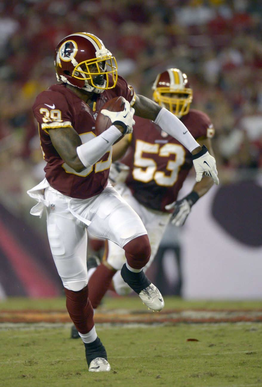 Washington Redskins cornerback David Amerson (39) runs after making an interception as linebacker Bryan Kehl (53) watches during the first half of a preseason NFL football game against the Tampa Bay Buccaneers in Tampa, Fla., Thursday, Aug. 29, 2013.(AP Photo/Phelan M. Ebenhack)