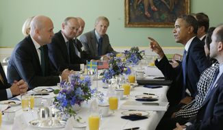U.S. President Barack Obama, right, and Swedish Prime Minister Fredrik Reinfeldt, left, converse during their bilateral meeting at the Rosenbad Building, Wednesday, Sept. 4, 2013, in Stockholm, Sweden. (AP Photo/Pablo Martinez Monsivais)