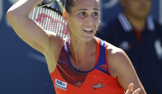 Flavia Pennetta, of Italy, follows through on a shot to Roberta Vinci, of Italy, during the quarterfinals of the 2013 U.S. Open tennis tournament, Wednesday, Sept. 4, 2013, in New York. (AP Photo/Kathy Willens)