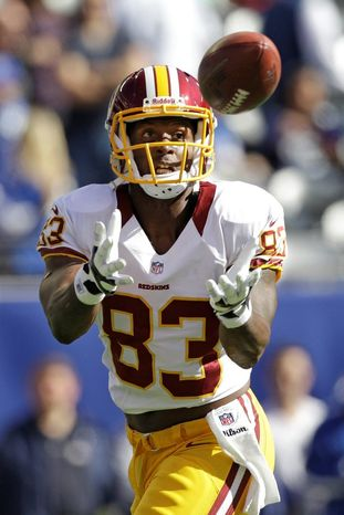 Coming off a season-ending injury, big things are expected of tight end Fred Davis in 2013. Sports Editor Mike Harris and Thom Loverro of ESPN 980 predict that Davis will lead the Redskins in receptions. (associated press)