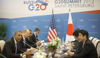 Syria was expected to be among the topics during the bilateral meeting between President Obama and Japan's Prime Minister Shinzo Abe at the G-20 Summit on Thursday. (Associated Press)