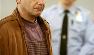 ** FILE ** John Esposito faces the court during his arraignment in Central Islip, N.Y., on charges he imprisoned 10-year-old Katie Beers in an underground bunker for 17 days, Jan. 21, 1993. Esposito, convicted for kidnapping Beers and hiding her under his Bay Shore, N.Y. home in 1992, died Wednesday, Sept. 4, 2013 at his jail cell in Sing Sing Correctional Facility in Ossining, N.Y. He was serving a 15 years-to-life prison term. (Associated Press)