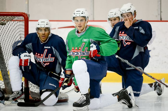 Forward Nathan Walker (79), center, takes a break with teammates during on-ice testing during the 2013 Capitals Rookie Camp at Kettler Capitals Iceplex, Arlington, Va., Thursday, September 5, 2013. (Andrew Harnik/The Washington Times)