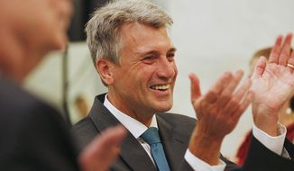 ** FILE ** In this July 31, 2013, file photo, Minnesota Mayor R.T. Rybak applauds after a performance by the Twin Cities Gay Men's Chorus at the Minneapolis City Hall. Rybak is hitting the road to promote his state's new gay marriage law. (AP Photo/Stacy Bengs, File)