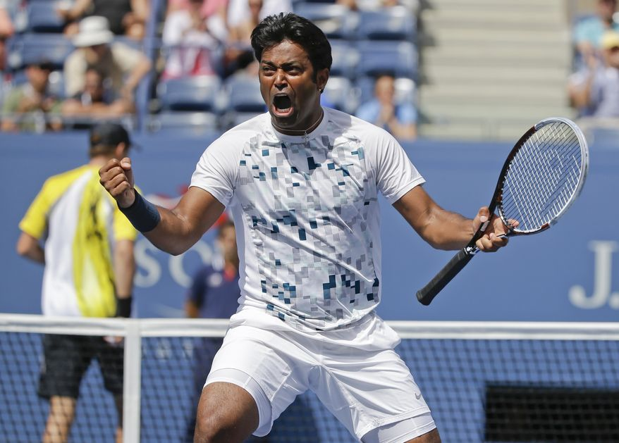 Leander Paes, of India, turns and reacts to his partner Radek Stepanek, of the Czech Republic, during the men's doubles quarterfinals against Mike and Bob Bryan at the 2013 U.S. Open tennis tournament, Thursday, Sept. 5, 2013, in New York. (AP Photo/David Goldman)