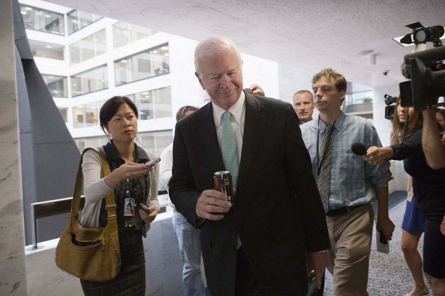 Senate Intelligence Committee Vice Chairman Sen. Saxby Chambliss, Georgia Republican, arrives on Capitol Hill for a closed-door briefing with national security officials on the situation in Syria on Sept. 5, 2013. President Obama has requested congressional authorization of military intervention in Syria in response to last month's alleged sarin gas attack in the Syrian civil war. (Associated Press)