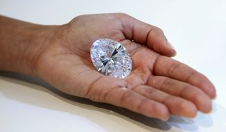 A 118-carat white diamond will be auctioned off by Sotheby's on Oct. 7 in Hong Kong. The gem has a presale estimate of $28 million to $35 million. The current record for a white diamond is $26.7 million. (AP Photo/Mary Altaffer)