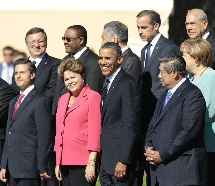 ** FILE ** U.S. President Barack Obama, front row center, smiles during a group photo of G-20 leaders outside of the Konstantin Palace in St. Petersburg, Russia on Friday, Sept. 6, 2013. Front row left to right, Mexico's President Enrique Pena Nieto, Brazil's President Dilma Rousseff and Indonesia's President Susilo Bambang Yudhoyono. (AP Photo/Ivan Sekretarev)