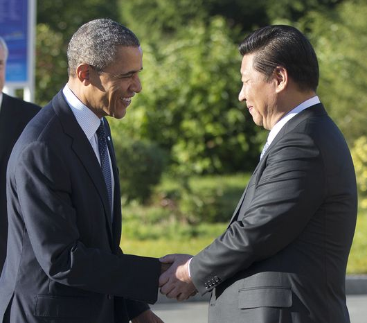 U.S. President Barack Obama, left, and China's President Xi Jinping, right, shake hands before their bilateral meeting at the G-20 Summit, Friday, Sept. 6, 2013 in St. Petersburg, Russia. (AP Photo/Pablo Martinez Monsivais)