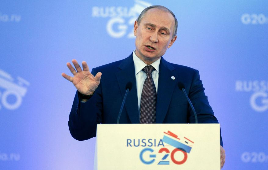 ** FILE ** Russia's President Vladimir Putin speaks during a media conference after a G-20 summit in St. Petersburg, Russia on Friday, Sept. 6, 2013. (AP Photo/Alexander Zemlianichenko)