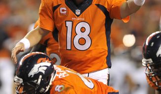 Denver Broncos quarterback Peyton Manning (18) calls a play against the Baltimore Ravens during the second half of an NFL football game, Thursday, Sept. 5, 2013, in Denver. (AP Photo/Jack Dempsey)