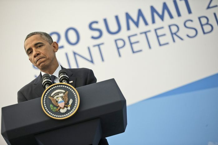 President Obama pauses as he answers a question regarding the ongoing situation in Syria during his news conference at the G-20 Summit in St. Petersburg, Russia, on Sept. 6, 2013. (Associated Press)