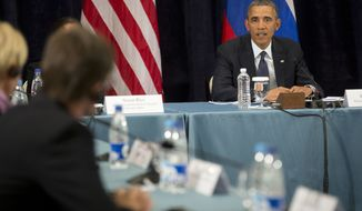 "President Barack Obama participates in a ""Civil Society Roundtable,"" Friday, Sept. 6, 2013, in St. Petersburg, Russia. At left is Igor Kochetkov chairman of the Russian LGBT Network. (AP Photo/Pablo Martinez Monsivais)"