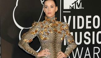 ** FILE ** Katy Perry at the MTV Video Music Awards in the Brooklyn borough of New York, Aug. 25, 2013. (Photo by Evan Agostini/Invision/AP, File)