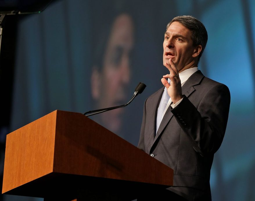 The advisory opinion issued by Virginia Attorney General Kenneth T. Cuccinelli II says that private and religious schools can receive public funds to pay for uniformed, armed and sworn officers and deputies to provide security. (Associated Press)