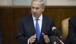 Israeli Prime Minister Benjamin Netanyahu speaks at the weekly Cabinet meeting in his Jerusalem office on Sunday, Sept. 8, 2013. (AP Photo/Uriel Sinai, Pool)