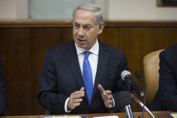 Israeli Prime Minister Benjamin Netanyahu speaks at the weekly Cabinet meeting in his Jerusalem office on Sunday, Sept. 8, 2013. (AP Photo/Uriel Sinai, Pool)