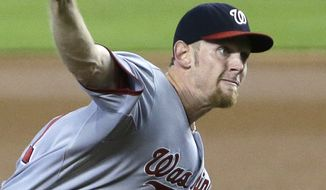 Washington Nationals' Stephen Strasburg delivers a pitch during the first inning of a baseball game against the Miami Marlins, Sunday, Sept. 8, 2013, in Miami. (AP Photo/Wilfredo Lee)