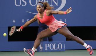 Serena Williams returns a shot to Victoria Azarenka, of Belarus, during the women's singles final of the 2013 U.S. Open tennis tournament, Sunday, Sept. 8, 2013, in New York. (AP Photo/David Goldman)
