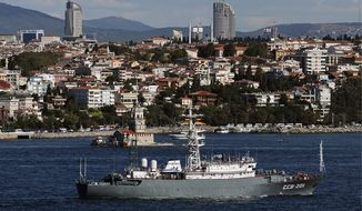 Moscow on a mission: A Russian military intelligence ship leads a naval fleet through the Bosporus on Thursday en route to the eastern Mediterranean for observation of U.S. ships and to serve as a roadblock to international action against Syria. (Associated Press)