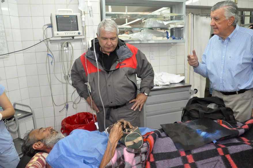 Uruguayan Raul Gomez talks with San Juan's state Gov. Jose Gioja (right) as he recovers at a hospital in San Juan, Argentina, on Sept. 8, 2013. The 58-year-old man who spent four months lost while trying to walk across the Andean mountains is recovering in an Argentine hospital. It wasn't clear at first what led Gomez with apparently no mountaineering experience to make the trek from Chile. Now it turns out that Gomez was fleeing from the law. Chilean authorities say child sex abuse charges were filed against him in April. (Associated Press)