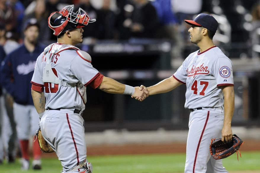 Washington Nationals left-hander Gio Gonzalez, left, gets a handshake from catcher Wilson Ramos after his one-hit shutout over the New York Mets in the Nationals' 9-0 victory. Gonzalez was inches from a no-hitter. (Associated Press photo)