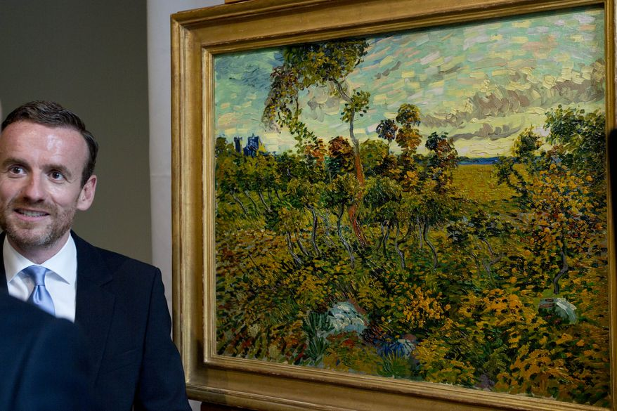 "Van Gogh Museum Director Axel Ruger is interviewed as he stands next to the newly discovered ""Sunset at Montmajour"" by Dutch painter Vincent van Gogh during a press conference at the museum in Amsterdam on Monday, Sept. 9, 2013. The museum says it has identified the long-lost van Gogh painting, which spent years in a Norwegian attic, as the first full-size canvas by the Dutch master discovered since 1928. The painting belongs to an unidentified private collector, the museum says. (AP Photo/Peter Dejong)"
