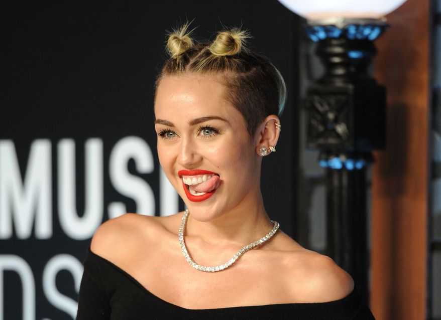 Singer Miley Cyrus attends the MTV Video Music Awards in the Brooklyn borough of New York on Sunday, Aug. 25, 2013. (Evan Agostini/Invision/AP)