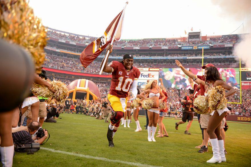 Washington Redskins quarterback Robert Griffin III (10) takes the field as the Washington Redskins play the Philadelphia Eagles in Monday Night NFL football at FedExField, Landover, Md., Monday, September 9, 2013. (Andrew Harnik/The Washington Times)