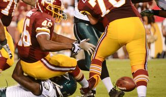 Washington Redskins running back Alfred Morris (46) fumbles on the first offensive play of the game as the Washington Redskins play the Philadelphia Eagles in Monday Night NFL football at FedExField, Landover, Md., Monday, September 9, 2013. (Andrew Harnik/The Washington Times)