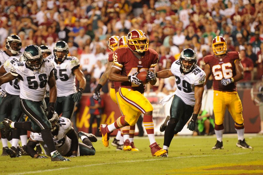 Washington Redskins running back Alfred Morris (46) scores on a 5 yard run play in the third quarter as the Washington Redskins play the Philadelphia Eagles in Monday Night NFL football at FedExField, Landover, Md., Monday, September 9, 2013. (Andrew Harnik/The Washington Times)