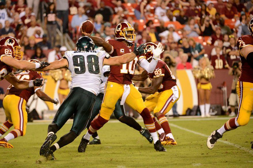Washington Redskins quarterback Robert Griffin III (10) throws in the third quarter as the Washington Redskins play the Philadelphia Eagles in Monday Night NFL football at FedExField, Landover, Md., Monday, September 9, 2013. (Andrew Harnik/The Washington Times)