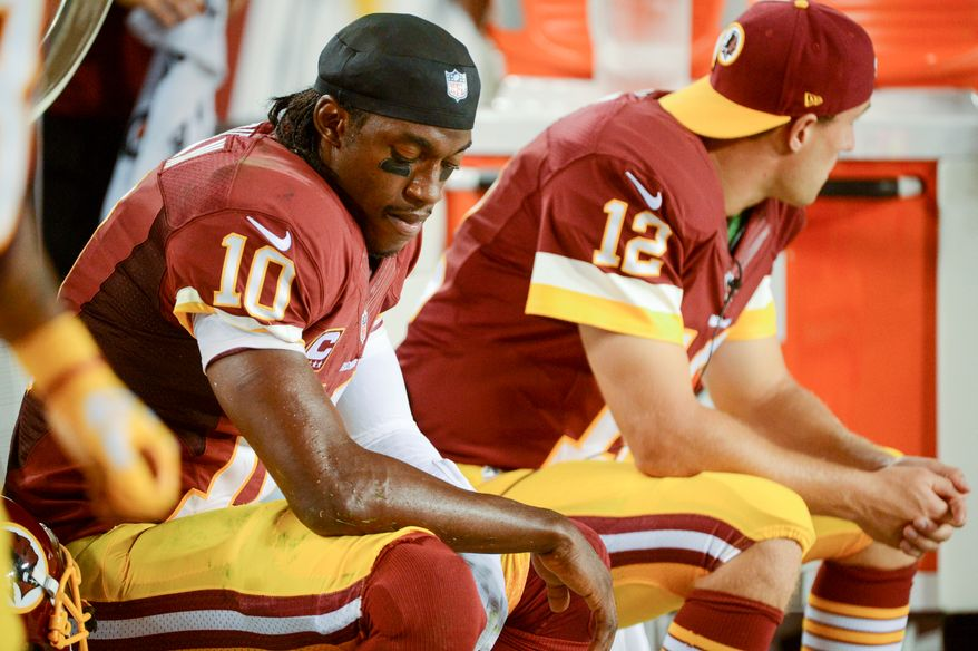 Washington Redskins quarterback Robert Griffin III (10) sits on the sideline in the third quarter as the Washington Redskins play the Philadelphia Eagles in Monday Night NFL football at FedExField, Landover, Md., Monday, September 9, 2013. (Andrew Harnik/The Washington Times)