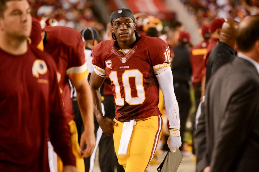 Washington Redskins quarterback Robert Griffin III (10) on the sideline in the third quarter as the Washington Redskins play the Philadelphia Eagles in Monday Night NFL football at FedExField, Landover, Md., Monday, September 9, 2013. (Andrew Harnik/The Washington Times)
