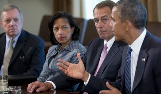 ** FILE ** President Barack Obama speaks to media in the Cabinet Room of the White House in Washington, Tuesday, Sept. 3, 2013, before a meeting with congressional leaders to discuss the situation in Syria. From left are, Senate Majority Whip Richard Durbin of Ill., National Security Adviser Susan Rice, House Speaker John Boehner of Ohio and the president. (AP Photo/Carolyn Kaster)