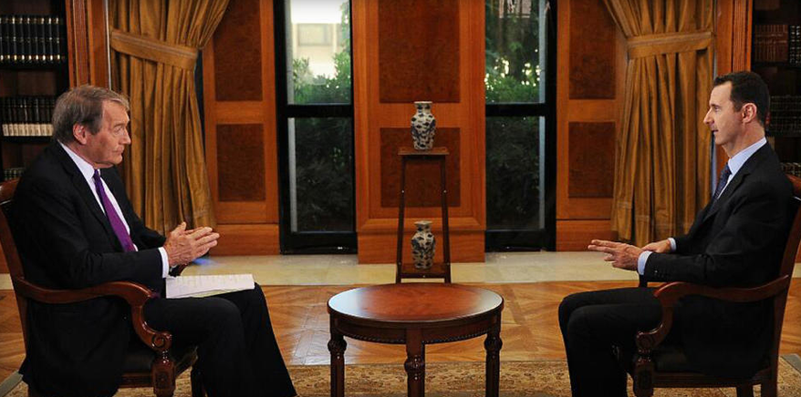 CBS and PBS correspondent Charlie Rose scored an interview with Syrian President Bashar al Assad. In it, Assad denied using weapons and accused President Obama of following in the foot steps of GEorge W. Bush. The interview airs in full on Monday — a day ahead of Obama's address to the nation. (screen shot from CBS)