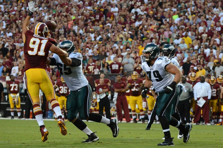 Washington Redskins linebacker Ryan Kerrigan (91) swats down a pass from Philadelphia Eagles quarterback Michael Vick (7) that is revered by Washington Redskins cornerback DeAngelo Hall (23) for a touchdown during first quarter action as the Washington Redskins play the Philadelphia Eagles in Monday Night NFL football at FedExField, Landover, Md., Monday, September 9, 2013. (Dan Decook / For The Washington Times)